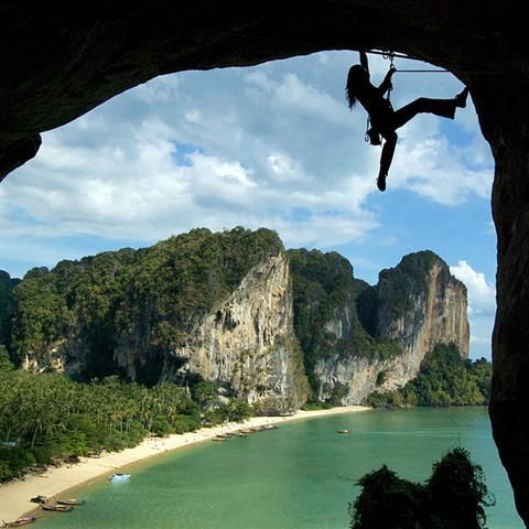 Climber hanging from overhanging rock face